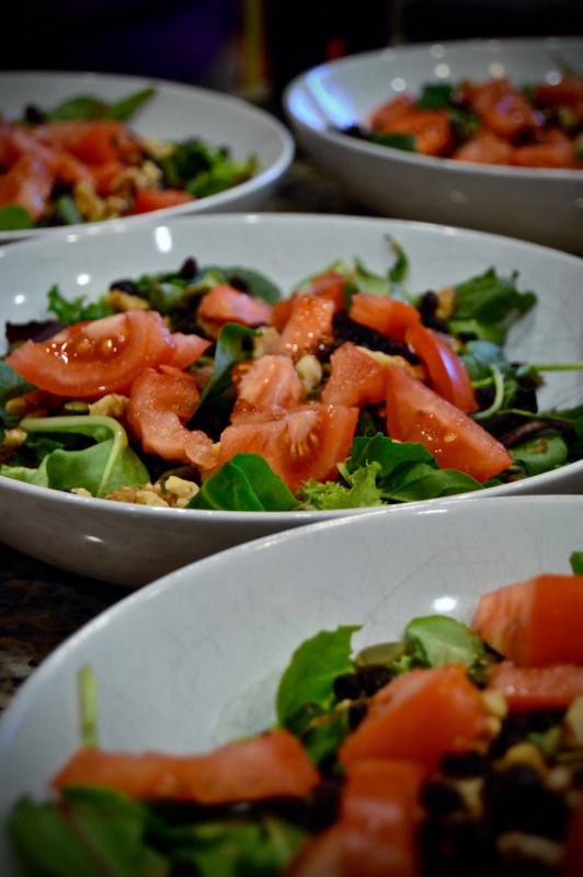 Leafy green salad with tomatoes and pumpkin seeds